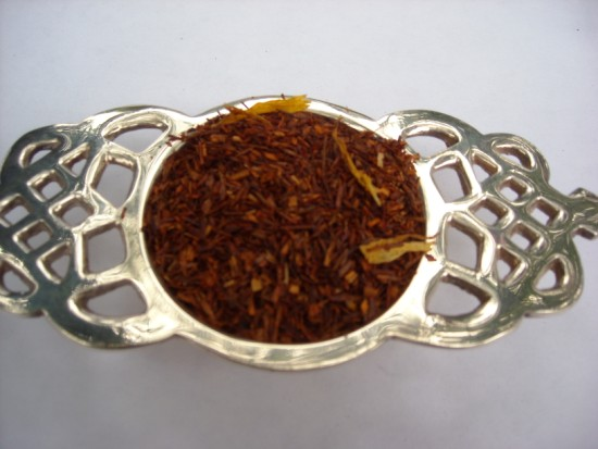 Raspberry in Paris Rooibos Tea - This delicately flavored rooibos invokes the mellow taste of a fresh raspberry.  When sipping this lovely tea, picture yourself in a fruit stall in Montmartre, basket in hand, picking a pound of succulent red berries.