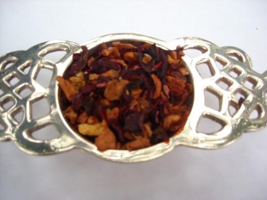 Passion Fruit - A mixture of passion fruit black tea, apple bits, hibiscus blossoms, rosehips.  Beautiful rich black tea!!